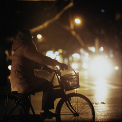 far away (memetic) Tags: china street urban woman 120 6x6 bicycle night mediumformat lights downtown fuji bokeh tl chinese  nanjing provia jiangsu  p6 pentaconsix sonnar 180mm  400x