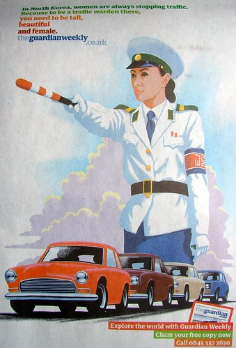 Pyongyang Traffic Warden in UK news advertisment poster 2508415148_a6617a6a18