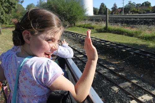 Esther waving to other train