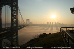 The George Washington Bridge (Chris Lupetti: www.chrislupetti.com) Tags: park nyc newyorkcity morning bridge shadow sun ny newyork art nature fog skyline clouds sunrise canon buildings river landscape landscapes photo newjersey flickr artist shadows artistic cloudy foggy nj bridges skylines cliffs thanksgivingday bobdylan flare hudsonriver hudson interstate goodmorning fortlee allrightsreserved georgewashingtonbridge palisades digitalphotography lupetti landscapephotography bergencounty blueribbonwinner flickrphotos newjerseyartist digitalphotographer thehudsonriver foggybridge herecomestheson newyorkartist landscapephotographer fortleenewjersey flickraward artisticphotograph megashot chrislupetti newyorkphotographer thatluckyoldsun newjerseyphotographer allrightsreserved20072008 photographybychrislupetti njartist chrislupettiphotography flickrphotograph miracleonthehudson bergencountyartist chrisjudelupetti luxtop100