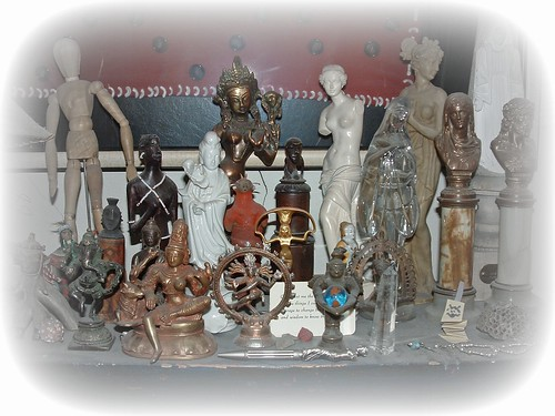 a collection of female/goddess statuettes