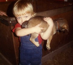 Cody & Pup..holding back the years (priscilla.starling) Tags: wood old family blue light boy red dog brown color cute love smile face puppy kid holding colorful child bright photos tail butt son blonde years pup cody hold youthnaturewatch priscillastarling seniorpictures20yrsolder