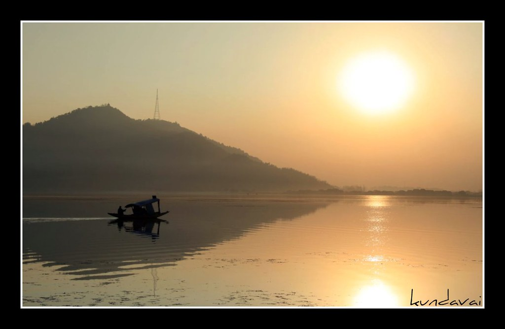 Shikara in Dal lake during sunset