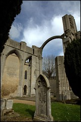 abbey through the hedge (*Melody*) Tags: trees sky building abbey architecture clouds tombstone ruin arches lincolnshire hedge crowland pfogold