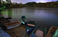 five boats (long exposure) (chris frick) Tags: trees light sky lake black water colors leaves bulb night germany dark boats nice neon nightshot image dusk branches calm shore serenity bergsee soe ambiance wideangel longtimeexposure longexposer nohdr flickrphotoaward programmflash