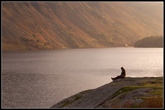 Solitary (ShinyPhotoScotland) Tags: autumn light sunset red sunlight lake scale water silhouette composition quiet colours emotion lakedistrict thoughtful human reflective solitary wastwater mellow pondering thirds naturewatcher