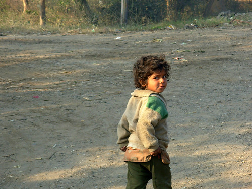 A child running near a railway crossing