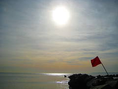 flag (pondblue) Tags: nyc red sun beach coneyisland rocks january calm sound boardwalk crazyweather lifeisart