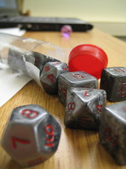 Silver dice spilling out of tube (nao.nozawa) Tags: dice nerd dungeonsdragons dnd rpi nerdiness
