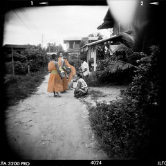 tinted.alms (jssutt) Tags: submitted holga buddhism laos lao alms buddhistmonks bwphotos blackandwhitephotos 5photosaday holgaplasticcamera earthasia jssutt jeffsuttlemyre