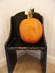Black vintage chair with pumpkin
