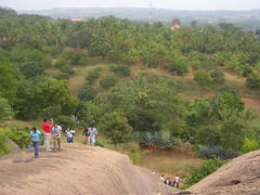 Climbing up to do the rappelling act (aanjhan) Tags: trekking bangalore rappelling rbin ramnagar chimneyclimbing