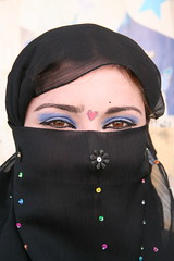 Blue Shadow and a Heart (hazy jenius) Tags: trip travel portrait people woman veil muslim islam middleeast hijab makeup adventure backpacking journey syria niqab deirezzur deirezzor deirazzur