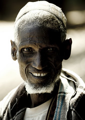 Old Afar man in Bati, Danakil, Ethiopia (Eric Lafforgue) Tags: africa portrait people men smile face smiling vertical beard photography african culture tribal tradition ethiopia tribe ethnic adultsonly oneperson tribo frontview confidence traditionalculture hornofafrica ethnology afar eastafrica thiopien etiopia toothysmile ethiopie traditionalclothing realpeople etiopa colorimage lookingatcamera onlymen onemanonly  traveldestination danakil etiopija 1people pastoralist ethiopi  africanculture etiopien etipia  etiyopya  nomadicpeople  mg0303  asaita  assayta