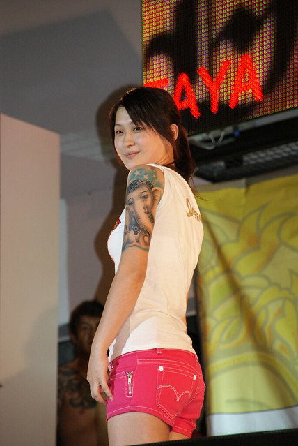 sexy asian girl with tattoo elaphant