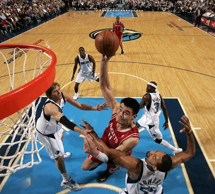 Yao Ming throws one down over Juwan Howard in the first half of the Rockets-Mavericks game Monday night.  Yao finished with 21 points on 9-of-12 shooting, and 11 rebounds in a heartbreaking loss to the Mavericks 107-98.