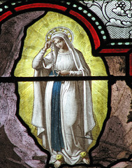 Detail of Our Lady of Lourdes praying the Rosary