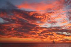 una barca che anela al mare eppure lo teme (miluzza) Tags: barca nuvole mare cielo nophotoshop rosso miluzza tramontodifuoco milasavi
