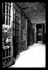 cells (paulhitz) Tags: old urban blackandwhite bw brick rot abandoned digital canon eos rebel rust bars paint decay steel urbandecay bricks cell abandon forgotten urbanexploration jail rusting rotten peel cells bnw 07 ue 18mm urbex 10sec f35 100iso xti xticanoneosdigitalrebeleos