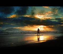 Skimboarder's Moment II (Soul101) Tags: reflection clouds sunrise dawn bravo shadows skimboarder nikond40 bagasbasbeach soul101 canimogisland