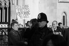 Dodi and Diana Executed (Paul Steptoe Riley) Tags: uk england blackandwhite london monochrome smoking diana lawcourts paparazzi dodi thestrand royalcourtsofjustice protesters policeman executed metropolitanpolice rcj