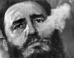 In a file photo Fidel Castro exhales cigar smoke during a March 1985 interview at his presidential palace in Havana. Ailing leader Fidel Castro resigned as Cuba's president early Tuesday Feb . 19, 2008, saying in a letter published in official online media that he would not accept a new term when the newly elected parliament meets on Sunday. (AP Photo/ Charles Tasnadi/file)