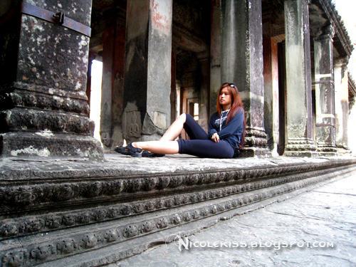 sitting at angkor wat
