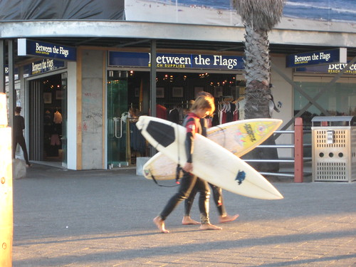 Surfers stroll through the streets of Sydney