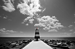 Roxanne's Lighthouse (s0ulsurfing) Tags: light shadow red sea sky blackandwhite bw cloud sunlight lighthouse white seascape black praia portugal water weather rock clouds contrast photoshop cutout grey mono bay coast rocks lighthouses skies shadows noiretblanc pov stripes wide perspective shoreline fluffy wideangle monotone ps pointofview coastal shore cumulus flare april coastline rays nautical algarve humilis roxanne sunrays shafts 2009 beams nube bold sunbeams foreground meteorology nephology selectivecolour praiadarocha 10mm postprocessing negroyblanco portimao sigma1020 s0ulsurfing rioarade westernalgarve cumulushumilis infinestyle