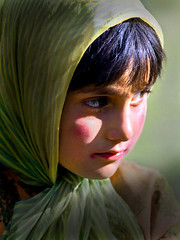 A hope of Kashmir.. (Divs Sejpal) Tags: light red portrait people india colors girl hope eyes colours peace child cheek dress expressions innocence kashmir jk kashmiri divs pahalgam divyesh intrestingness flickrexplore explored sejpal 50millionmissing