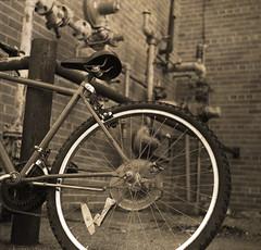 bike home (amazing84) Tags: bw 120 minnesota bike bicycle hp5 stewartville agfaisoletteiii october2007 xtol1112min