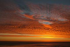 Last Sunset of 2007 - Half Moon Bay, CA (vgane) Tags: ocean california sunset shadow sky orange usa clouds contrast wow dark evening unique dramatic grand pacificocean dslr westcoast halfmoonbay sureal breathtaking impressive inspiring memorable naturesfinest canon30d ef24105mm mywinners abigfave impressedbeauty aplusphoto flickrdiamond top20orange betterthangood goldstaraward sf2007sunset