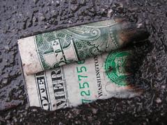 (Burned and wet dollar by gothick_matt via Flickr.com)