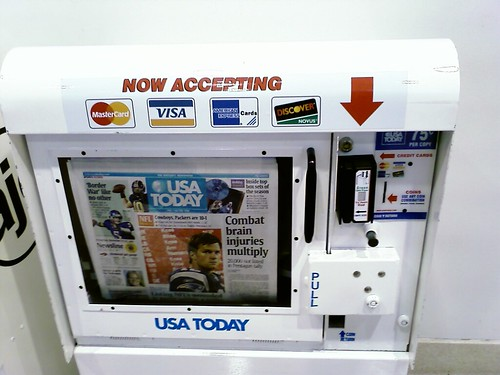 Newspaper stand accepts credit cards