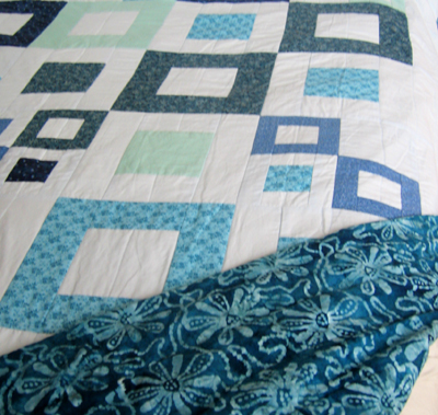 Blue squares quilt with back fabric