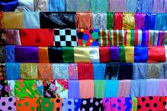 DE BOTIGUES / SHOPING (juli_modul) Tags: colors colours vivid fabric botiga tela roba shoping dscr1 sonydscr1 flickrsbest abigfave colorphotoaward ltytr2 ltytr1 ysplix brillianteyejewel colourartaward artlegacy teixit photosexplore