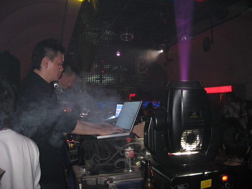 Chinese DJ's mixing music on their laptops