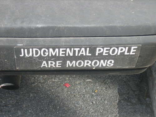 bumper sticker on a car that says Judgmental People Are Morons