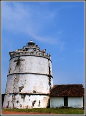 Love thy neighbor. And if he happens to be tall and debonair, it will be that much easier - Mae West (flickrohit) Tags: trip blue sky lighthouse white house fort goa rohit aguada thepca rohitgowaikar