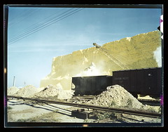 Loading box cars with sulphur, Freeport Sulphur Co., Hoskins Mound, Texas  (LOC) (The Library of Congress) Tags: railroad train vintage texas rail s slidefilm 1940s transparency traincar sulphur 4x5 lf canadianpacific libraryofcongress boxcar cp hopper largeformat element loading transparencies rollingstock crr historicalphotographs vachon johnvachon brazoriacounty clinchfield xmlns:dc=httppurlorgdcelements11 dc:identifier=httphdllocgovlocpnpfsac1a35435 hoskinsmound chemicalprocessing freeportsulphurco consumingtheyellowcorpse