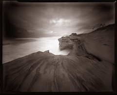 Cape Kiwanda, 15 seconds (Zeb Andrews) Tags: ocean bw oregon landscape coast cliffs pinhole pacificocean ilfordhp5 coastal pacificnorthwest 4x5 storms duotoned zeroimage capekiwanda tacomaartmuseum zero45 bluemooncamera zebandrews pinscapes incaseofawaterlanding yourcameramaybeusedasafloatationdevice nwlandscapes zebandrewsphotography