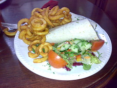 BBQ chicken with roast peppers wrap with curly fries at The Cumberland Bar Edinburgh