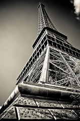 Ah... Paris (Xavier Donat) Tags: bw paris france tower art history monument metal sepia architecture spectacular high iron tour angle postcard perspective grand nopeople eiffel icon structure lookingup explore champdemars histoire blogged tall symbole touristique haut d300 parisien gustaveeiffel explored challengeyouwinner friendlycomments planeteyecom
