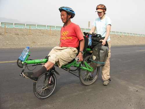 Fellow cycle tourists try out Marija's recumbent bike near Dabancheng, Xinjiang Province, China