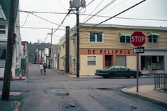 (patrickjoust) Tags: shenandoah pennsylvania schuylkillcounty defelippis couple walking rowhouse fujicagw690 kodakportra160 6x9 medium format 120 rangefinder 90mm f35 fujinon lens c41 color negative film manual focus analog mechanical patrick joust patrickjoust usa us united states north america estados unidos autaut pa small town people old car auto automobile vehicle parked alley street