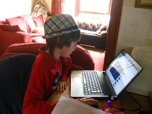 Cam in funky hat, borrowing my laptop