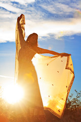 Catch the sun (Anna Gorin) Tags: sunset portrait woman sun girl silhouette canon veil desert indian sigma lensflare 7d flare sunburst sunrays youngwoman goldenhour sheer 70200mm fulllengthportrait