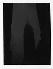 Empire State Building in the fog (Xylographile) Tags: nyc newyorkcity blackandwhite bw newyork tower fog skyline architecture skyscraper buildings mediumformat polaroid noir manhattan midtown empirestatebuilding artdeco instantphotography polaroidlandcamera polaroid660 peelapartfilm instandfilm