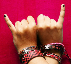 [we rock too much for one hand] \mm/ (S) Tags: black skull hands bracelets nailpolish rockon soulmates hotpink
