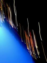 Slide, the City Skyline (Philip Schade) Tags: city blue roof light red orange sun white black holland netherlands station amsterdam yellow night licht blauw nacht dusk nederland shift slide down move gas pump cc geel rood zwart wit philip zon stad halte oranje dak pomp schemer schade ondergang benzine beweeg verplaats glijd clevercreativecaptures philipschadephotography